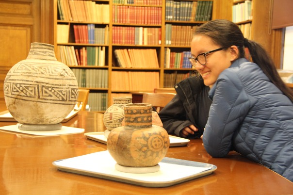 Art student examines a negative painted bottle from the Etowah site, Georgia.
