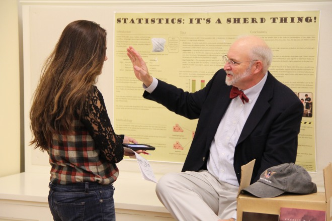 """Dr. Emerson """"Tad"""" Baker '76 discusses his research with a reporter from The Phillipian."""