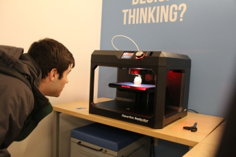 Jacob inspecting the 3D printer