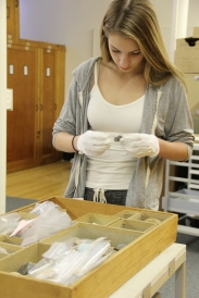 A student sorting the artifacts