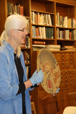 Catherine holding a Navajo basket