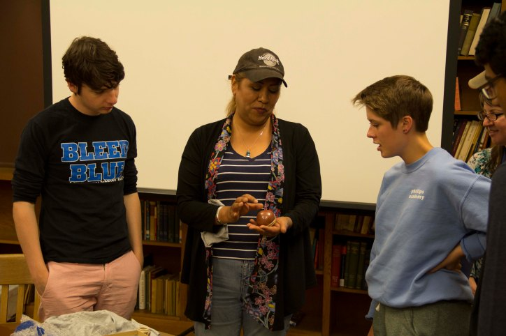 Alana and other work duty students learn about Pueblo pottery from Dominique Toya