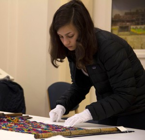 Photo of Margot Steiner with museum textiles