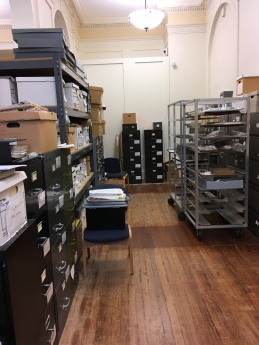 East wall, previous arrangement of the archives storage area: mostly filing cabinets and boxes piled on top.