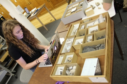 Work duty student inventorying a drawer