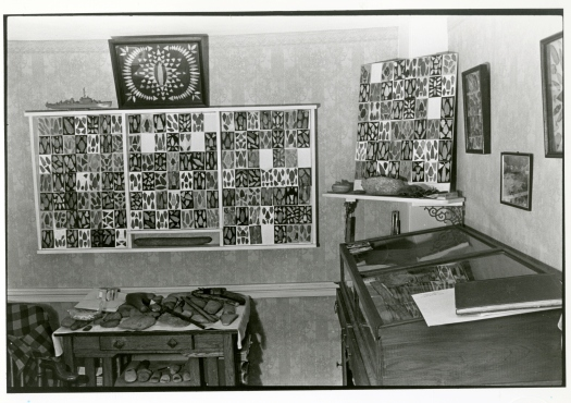 This black and white photograph depicts several cabinets in the home of Massachusetts native Roy Athearn, whose 13,000 object collection was significant.