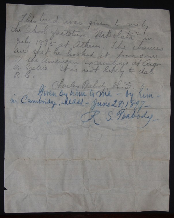 Image of the note from Charles Peabody explaining the origin of the little ceramic bird with Robert Peabody's appended note.