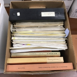 A typical box before sorting out the books