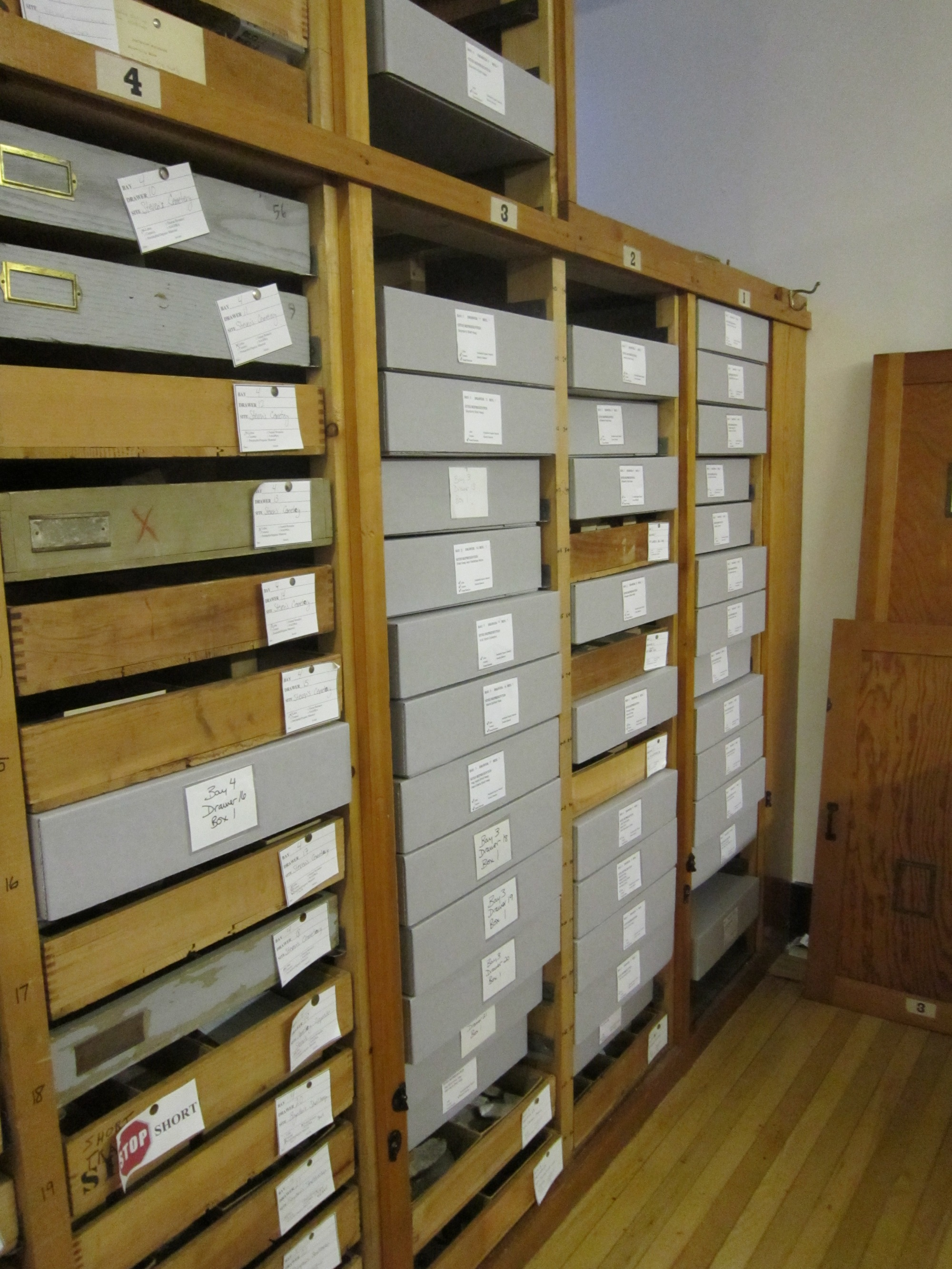 A storage bay with a mixture of drawers and boxes