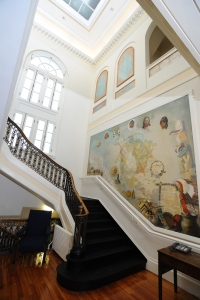 Image of the Stuart Travis mural and central staircase.