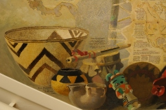 Artifacts illustrated in the Travis mural include baskets from California, a Katchina, and Iroquois and Algonquin musical instruments. Photography by Gil Talbot.
