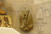 Stuart Travis modeled the Tuxtla statuette in low relief, highlighting this Olmec figurine's glyphs and bird-like costume. Photography by Gil Talbot.
