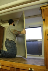 Contractor covering the windows with insulation