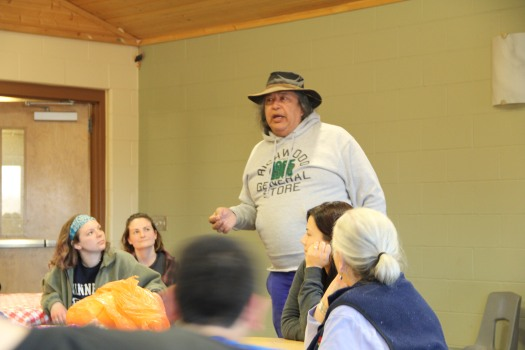 Image of White Earth Land Recovery Project Executive Director Bob Shimek talking to tribal members and college service learning students, March 2016.