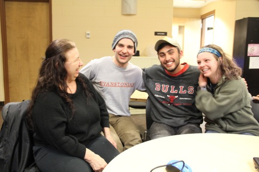Image of three college students talking with tribal member Diana King, taken March 2016.