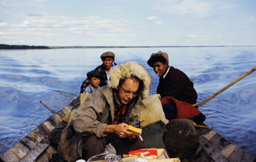 Richard MacNeish in canoe in the MacKenzie River, Canada, during his survey work in the 1950s