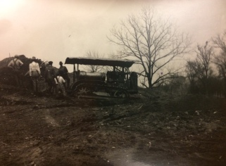 Tractor being used to excavate mound