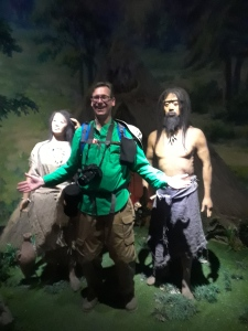 Image of Peabody director Ryan Wheeler with reconstructions of Banpo woman and man.