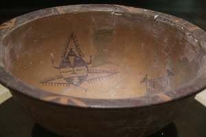 Image of painted pottery vessel from Banpo site, shows stylized anthropomorphic fish.