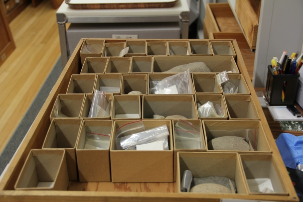 This is an example of what drawers look like before I work on them. All of these brown boxes hold artifacts.