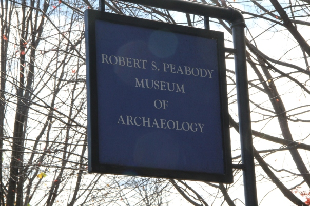Image of blue sign for the Robert S. Peabody Museum of Archaeology on Andover's Main Street.
