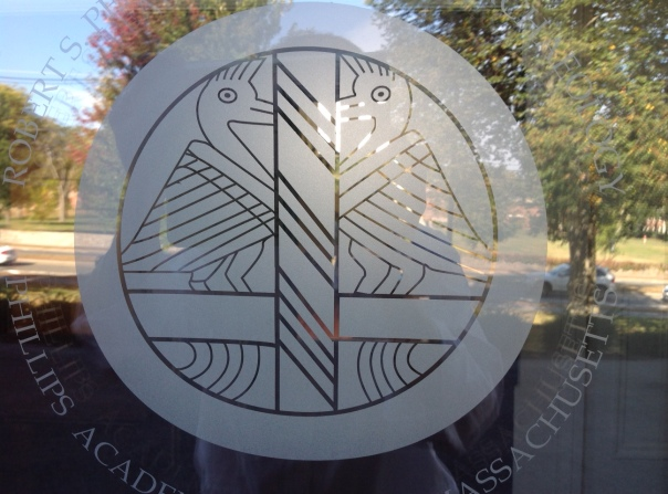 Image of old Peabody logo, on glass panel, from front door.