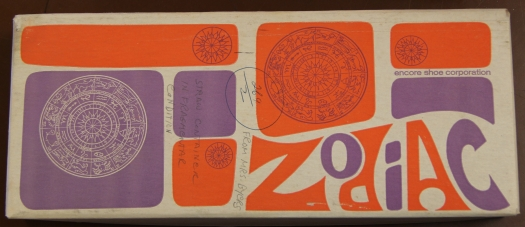 Image of 1970s-1980s shoe box with purple and orange mid-century design.