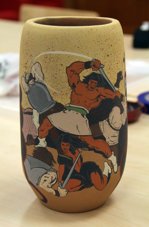 Image of Jason Garcia's Pueblo Revolt 1680 ceramic vessel, with brightly painted, comic-book style figures of Po'Pay and Spanish soldiers.