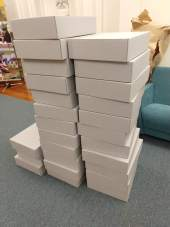 A stack of archival boxes waiting for their objects!
