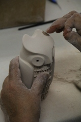 Image of Maxine Toya working on owl figurine.