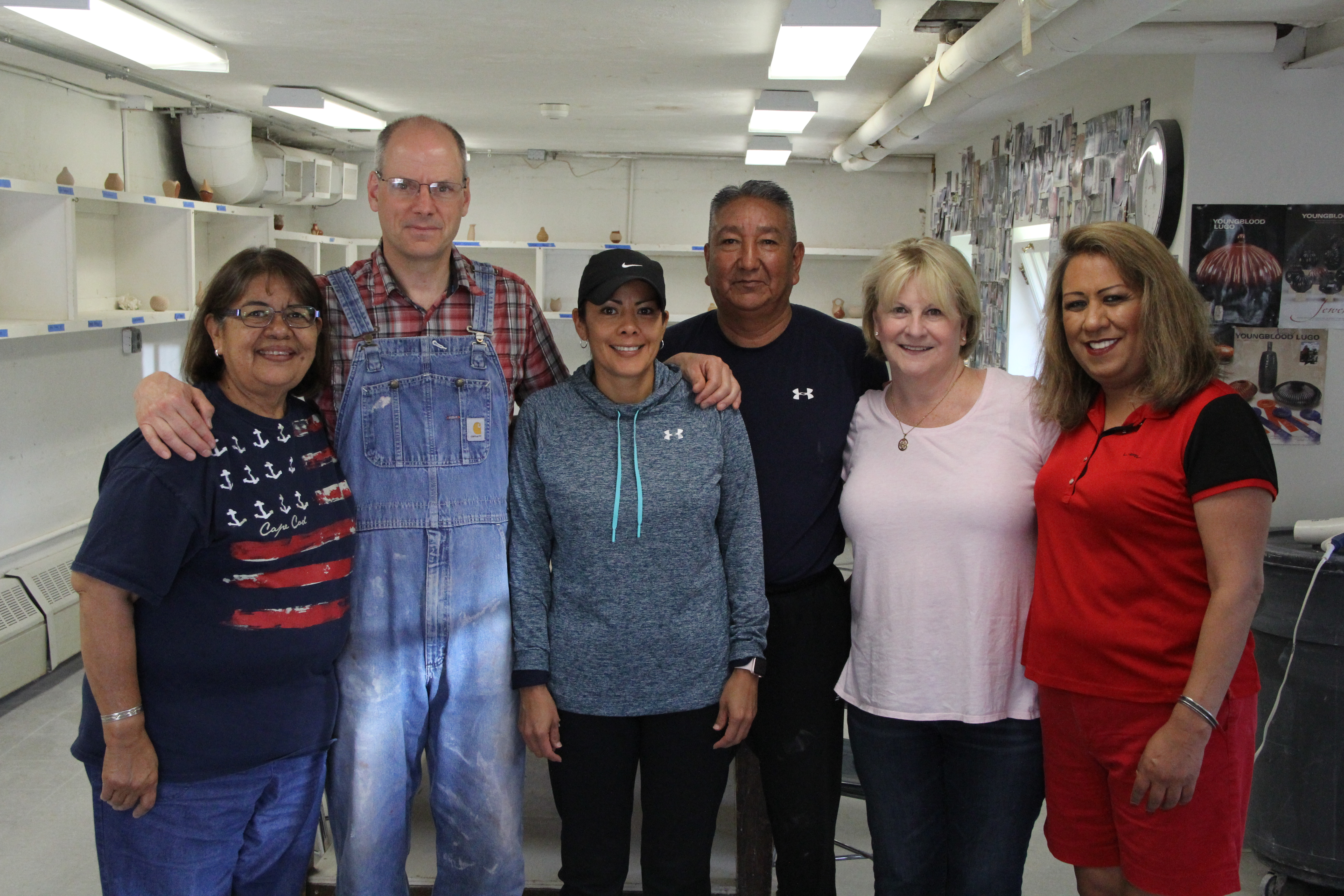 Image of Pueblo potters with ceramics instructor and blog author.