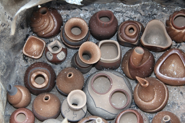 Image of soot covered vessels post firing.