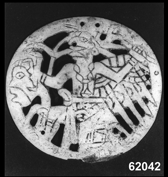 Image of shell gorget with dancing birdman figure.