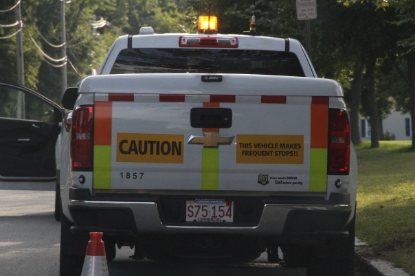 Image of utility truck parked next to Peabody building.