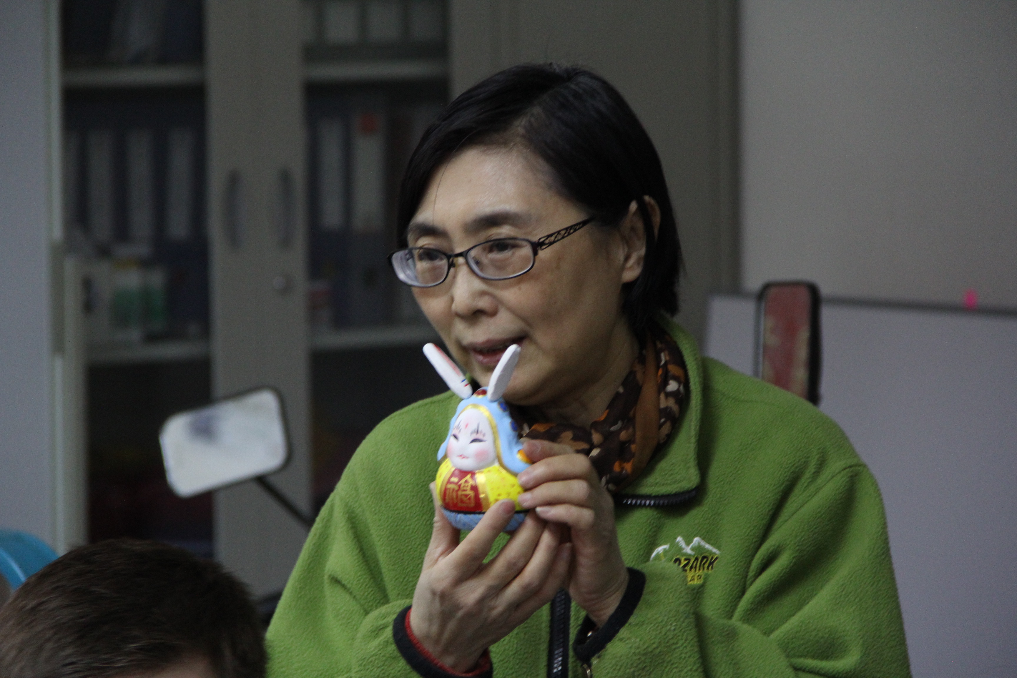 Image of Beijing Tu'er Ye artist with figurine.