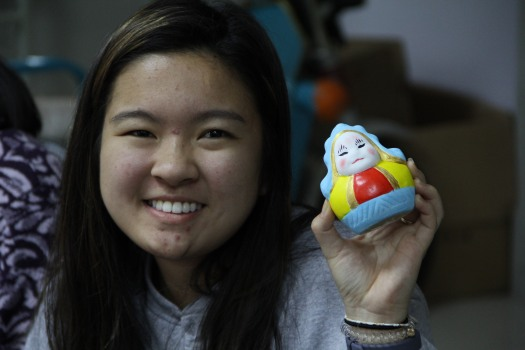 A student shows off her painted rabbit figurine.