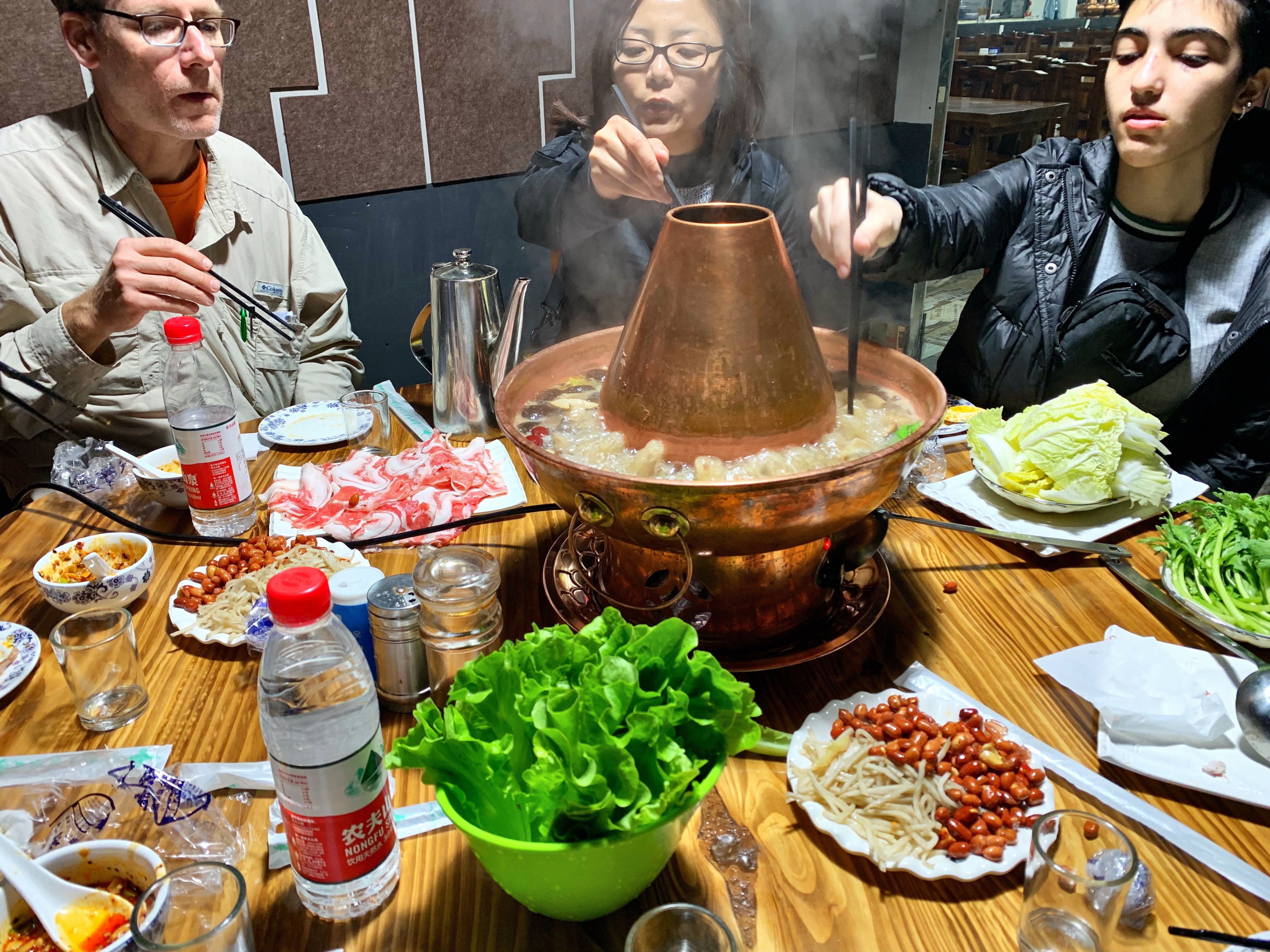 Image of students and chaperones sharing hot pot in Luoyang.
