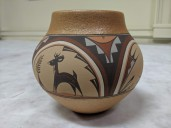 Images of pottery vessel with deer and human painted figures.
