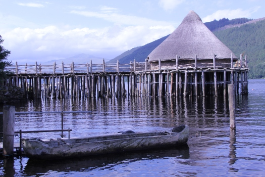 Image of thatched pile dwelling reconstruction at Scottish Crannog Centre.