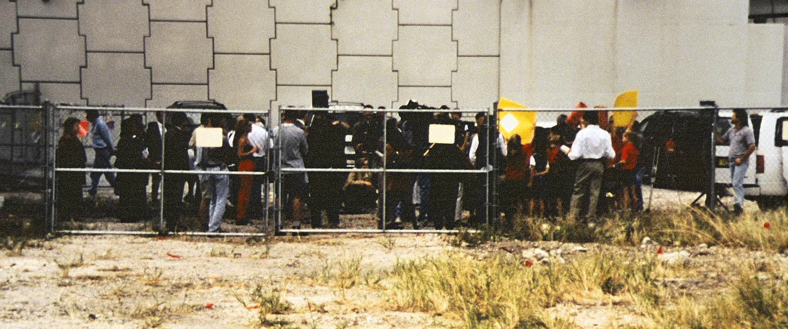 A crowd of reporters outside the chain link fence at the Miami Circle site.