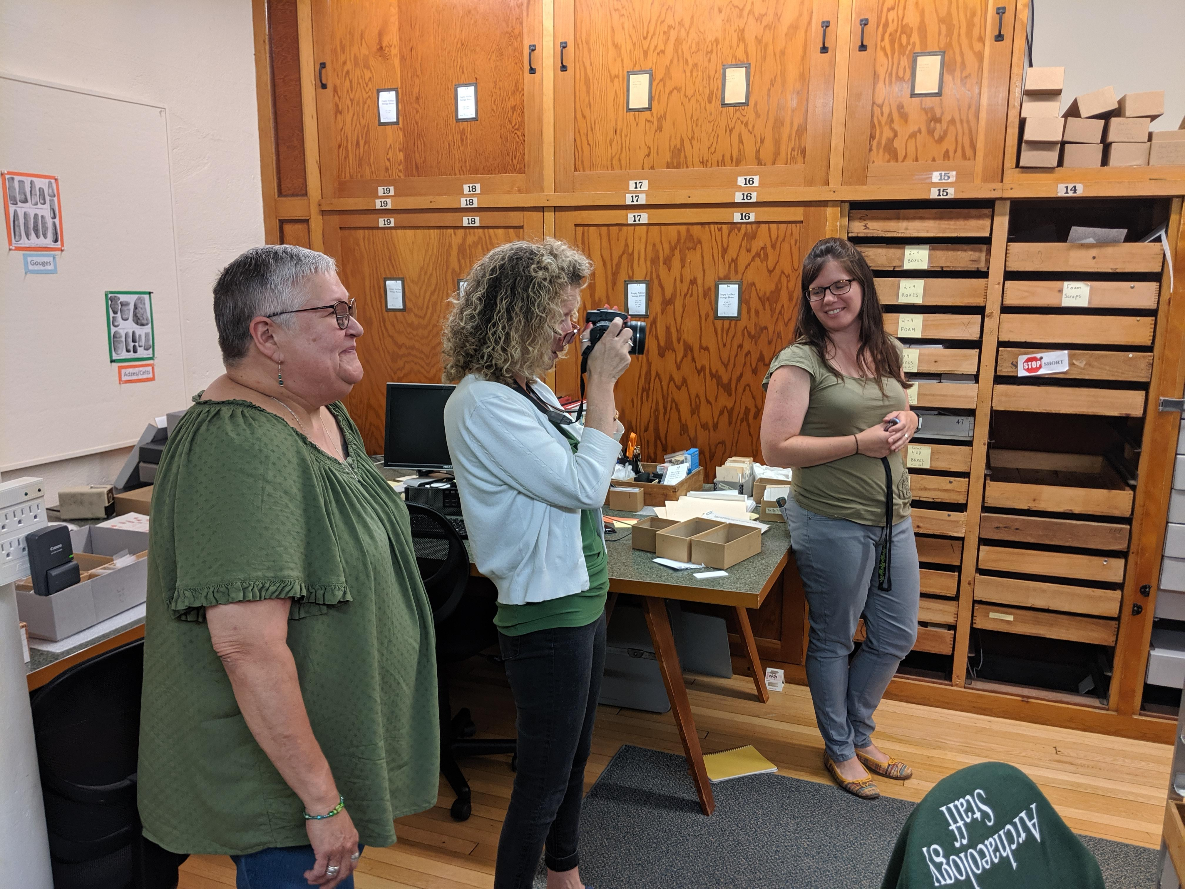 Image of tribal representatives in the Peabody Institute collection space with Marla Taylor, curator of collections